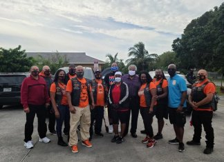 Black Lions Homestead Motorcycle Club members pose with Florida City Mayor Otis Wallace, Florida City Vice Mayor Sharon Butler, and Miami-Dade County Commissioner Kionne McGhee.