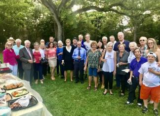Members and guests of the Rotary Club of Coral Gables are pictured enjoying an early evening social at Rotary Centennial Park.