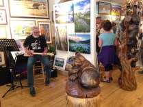 A guitarist plays a homemade instrument at this Gunnison, CO art gallery.