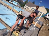 Intern Sarah cuts some serious #5 structural rebar for the foundation.