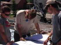 Intern Matt, Apprentice Jess and Straw and Timber foreman J.T. review the plans for clarification.