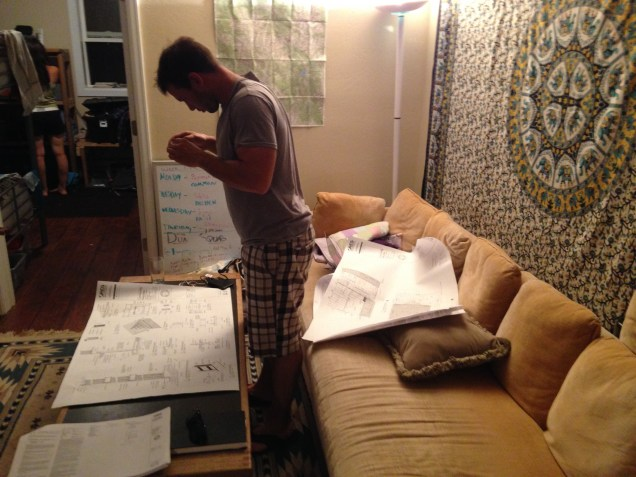 Intern Mike photographs our plans for his reference.