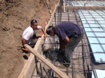 Our concrete subs inspect the forms for a final time before we pour.