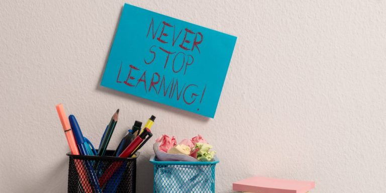 Hand written note above desk saying Never Stop Learning