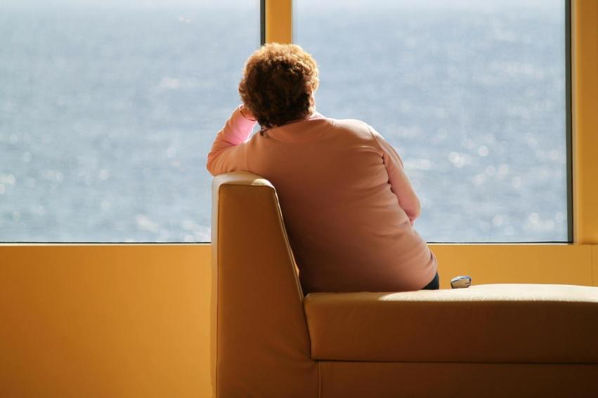 woman on sofa, facing window