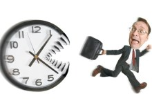 conceptual caricature of a caucasian business man in a suit as he runs away from a giant clock with big teeth