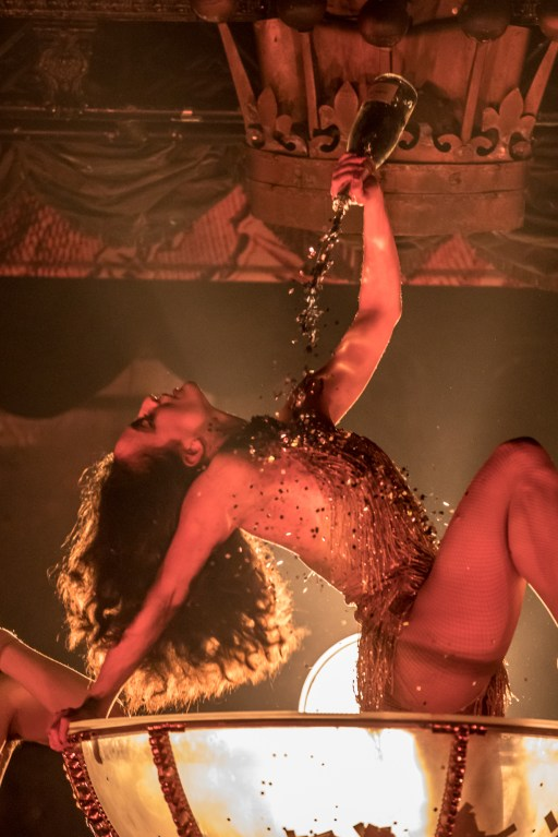 Burlesque Dancer in Champagne Coupe