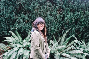 Dear Girl With Glasses in greenery