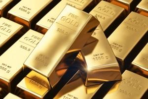 Cena złota spychana w dół przez silniejszego dolara