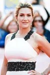 Image may contain: Evening Dress, Fashion, Clothing, Gown, Apparel, Robe, Kate Winslet, Human, Person, Woman, and Blonde