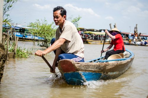 Boatmen on the Mekong
