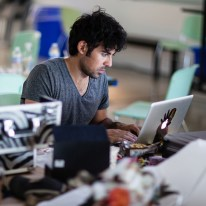 Samy surrounded by hardware and writing software