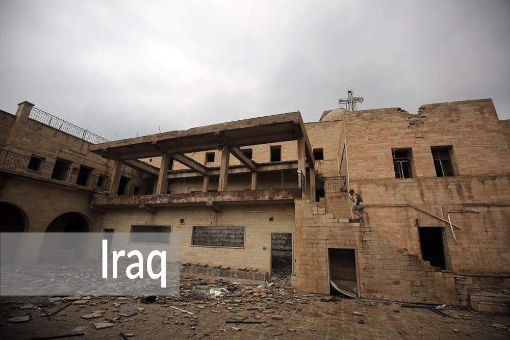 TOPSHOT - An Iraqi soldier inspects the debris on January 22, 2017 at St. George's Monastery (Mar Gurguis), a historical Chaldean Catholic church on the northern outskirt of Mosul, which was destroyed by Islamic State (IS) group in 2015. / AFP / AHMAD AL-RUBAYE        (Photo credit should read AHMAD AL-RUBAYE/AFP/Getty Images)