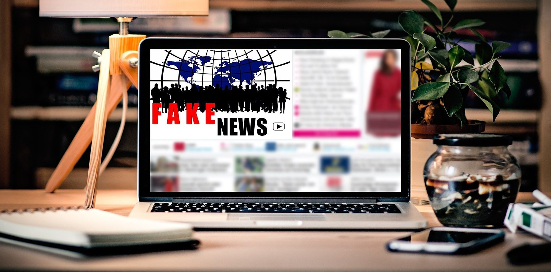 Picture of a laptop with fake news on it.