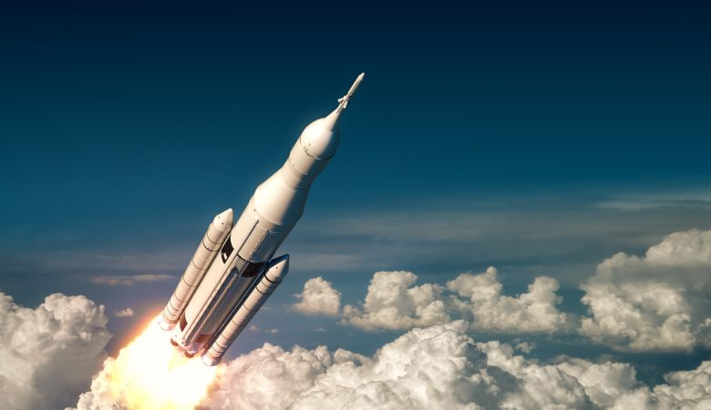 Flight Of Big Carrier Rocket Above The Clouds. 3D Illustration.