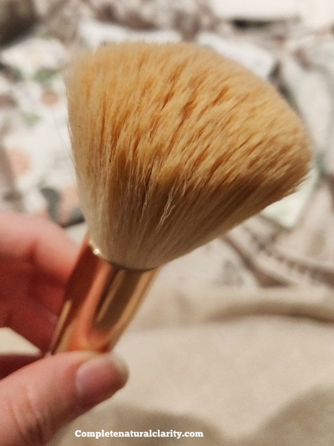A large, fluffy brush usually meant for Finishing Powder is ideal.