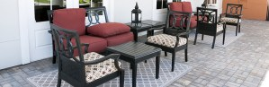 Elegant matching porch furniture on a paver floor and carpet