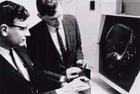 Two people playing Spacewar in the early 1960's