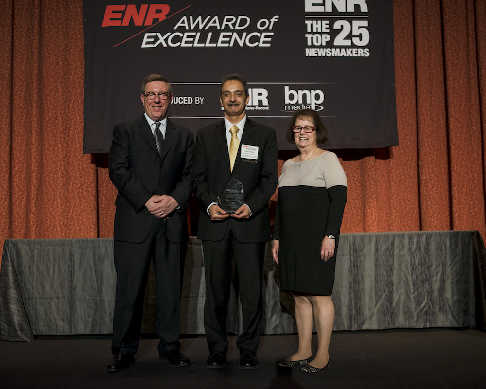 A photo of Dr. Dagher accepting an award