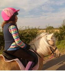 My daughter riding Crystal