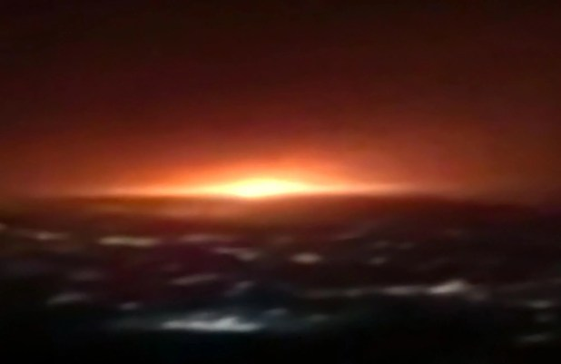 Blurred screenshot of an explosion in the night sky.