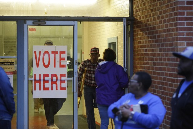 Alabama residents wait in line outside a polling station to cast their vote.