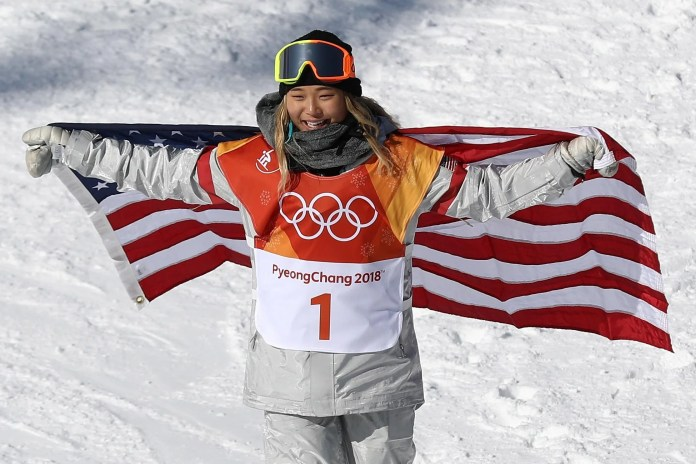 PYEONGCHANG-GUN, SOUTH KOREA - FEBRUARY 13:  Gold medalist Chloe Kim of the United States celebrates winning the Snowboard Ladies' Halfpipe Final on day four of the PyeongChang 2018 Winter Olympic Games at Phoenix Snow Park on February 13, 2018 in Pyeongchang-gun, South Korea.  (Photo by Clive Rose/Getty Images)