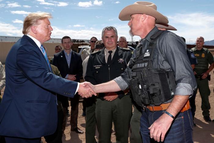Donald Trump shakes Mark Lamb's hand.