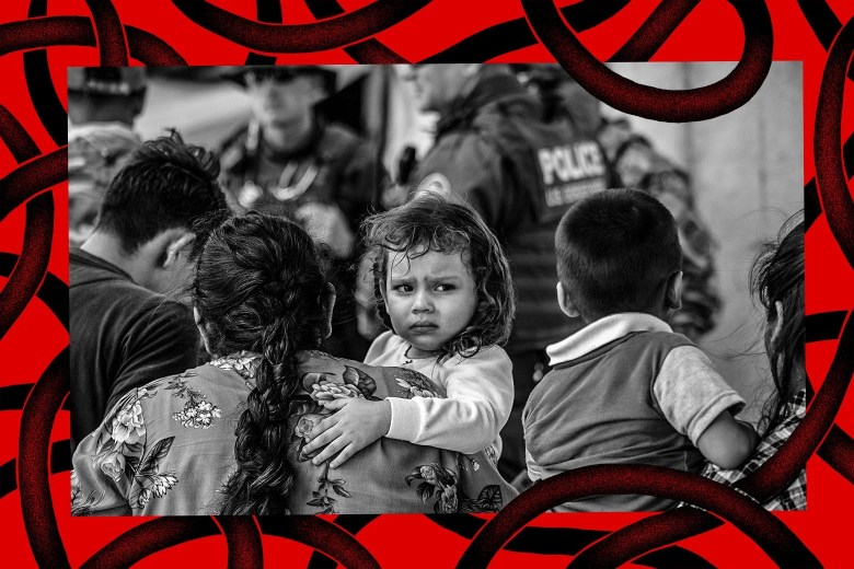 A photo illustration with a young immigrant girl looking at the camera, being carried by an adult as they wait to be interviewed by U.S. Border Patrol agents after they were taken into custody on July 02, 2019 in McAllen, Texas.