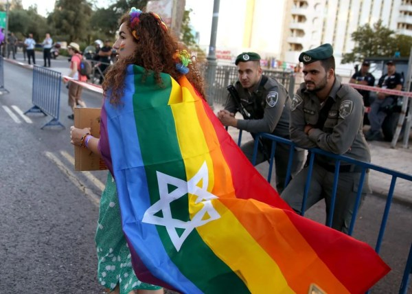 Demonstrators Carrying Star Of David Flags Kicked Chicago Dyke March