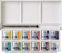 Caja de plástico abierta con 12 pastillas y un pincel