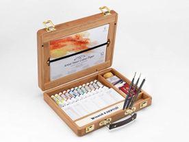Caja de Bambú abierta con tubos de acuarelas winsor and newton, pinceles y otros accesorios