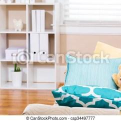 Aqua Sofa Mart Landers Road North Little Rock Ar Bright Living Room Interior With A Teddy Bear And Pillows Csp34497777