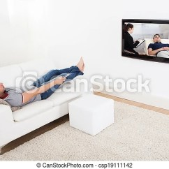 Tv Sofa Online Sofas Man On Watching Full Length Of Young Csp19111142