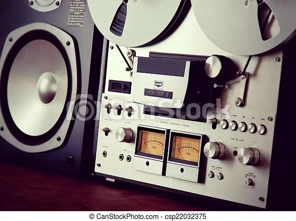 Analog stereo open reel tape deck recorder vu meter device closeup.