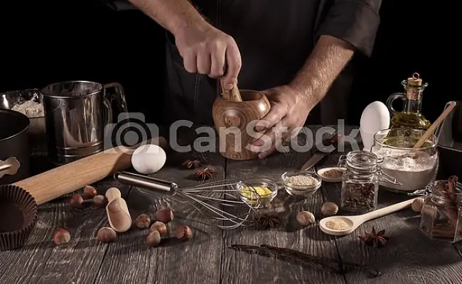 Baker S Hands Rubbing Spices In Mortar Isolated On Black