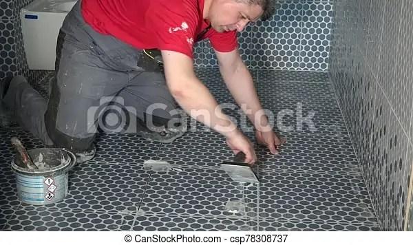 bathroom tile gaps filling with grout construction master tiling floor static shot canstock