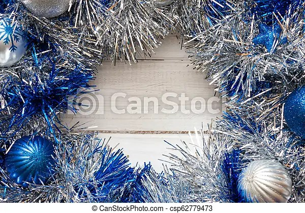 Blue And Silver Christmas Decorations Blue And Silver Christmas Wreath With Decorations On White Wooden Background