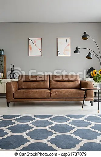 Blue Patterned Carpet And Leather Sofa In Grey Living Room Interior With Posters And Lamp Real Photo