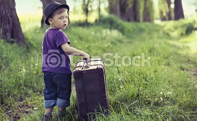 Stock Photography Of Little Man Leaving Home With Huge