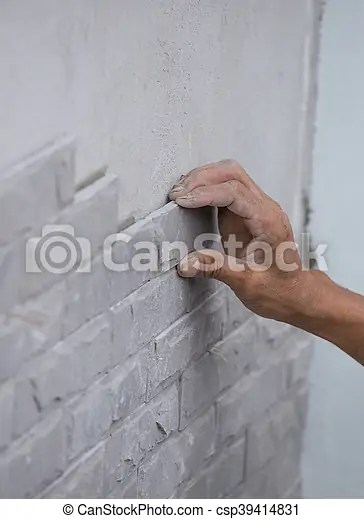 worker install stone wall tile with cement for house decoration stock images page everypixel