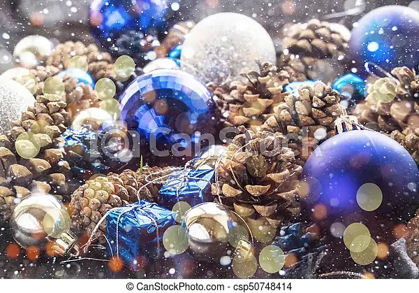 Christmas Background With Blue Silver Balls And Pinecone Christmas Background With Blue Ornaments And Snowy Pinecone And