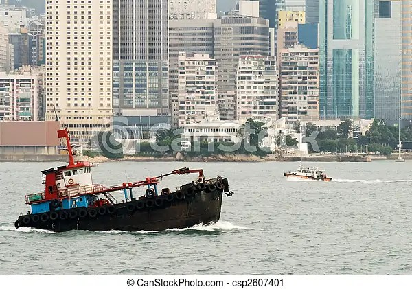 It is cityscape of fishing boat on victoria harbor in hong kong.