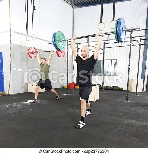 Clean and jerk workout at fitness gym center. Team squats and deadlift training at fitness center. weight workout at the gym.