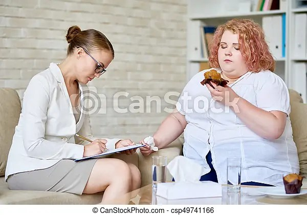 Compulsive eating disorder. Portrait of female psychologist taking notes on clipboard while consulting obese young woman eating cupcakes about ...