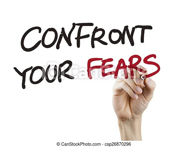 Confront your fears words written by hand over white background.