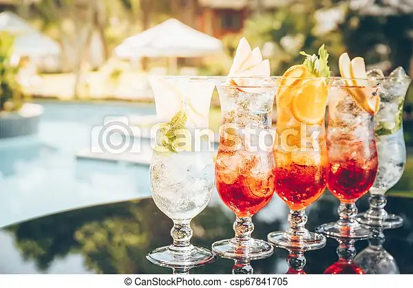 Craft Cocktails Near The Pool Vacation Summer Holiday Luxury Resort Concept Horizontal Toned Image Sunset Warm Hue