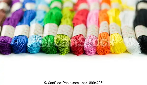 Embroidery thread. Colorful embroidery thread isolated on white background.