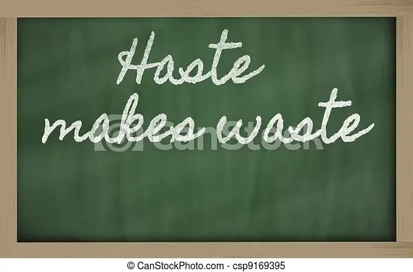 Expression - haste makes waste - written on a school blackboard. Handwriting blackboard writings - haste makes waste.