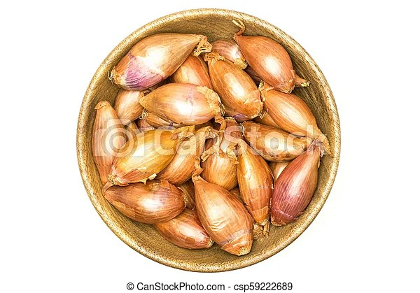 Fresh raw long shallot onion isolated on white. Long shallot in a wooden bowl top view isolated on white background.